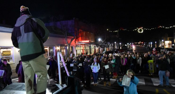 Geneseo Warms Moonlit Village with ChristmaSing Carols