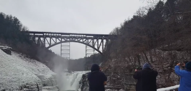 WATCH: Letchworth's New Arch Bridge Takes its First Train Across Gorge