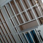 ARMED DRUG TRAFFICKER AND PRIOR FELON GOING TO PRISON