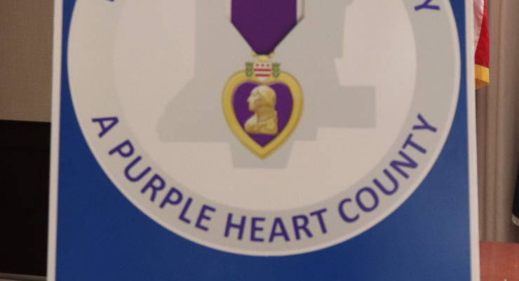 "Liv. Co. Honors Veterans With New ""Purple Heart County"" Signs"