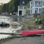 CARS LANDS IN LAKE  AFTER NO BRAKES ON BOOHER HILL RD.