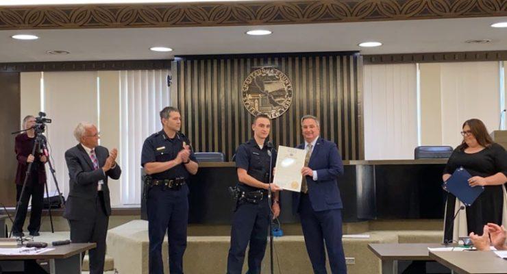 BORRELLO PRESENTS NYS SENATE COMMENDATION AWARD  TO OFFICER MARK CONKLIN
